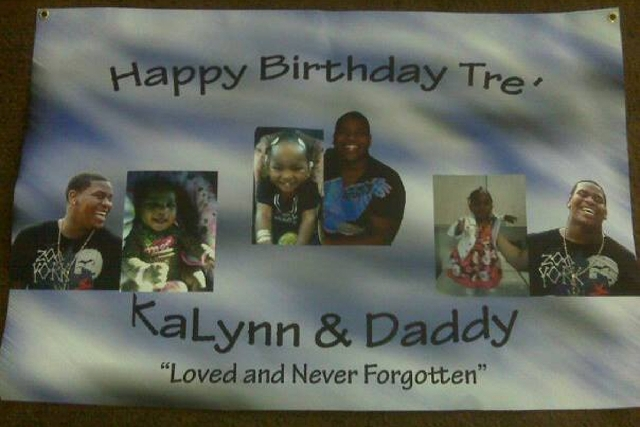 Images of Trevon Cole and daughter KaLynn are pasted on a birthday banner for Cole, who was shot dead by police on June 11, 2010.