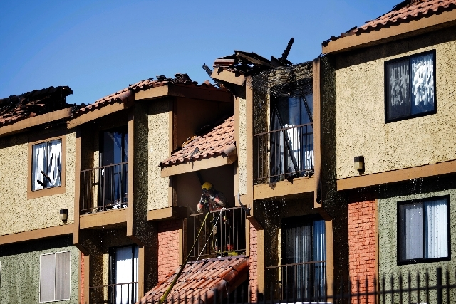 Las Vegas firefighters work at the scene of a three-alarm blaze at the Encantada apartment complex at 401 N. 28th Street in Las Vegas last Sunday. Stephen J. Tyson, 50, was charged Saturday with t ...