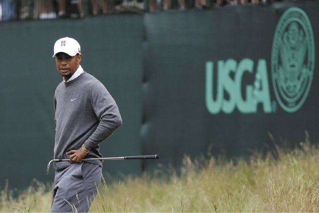 Tiger Woods looks at his lie on the 17th hole during the first round of the U.S. Open at Merion Golf Club on Friday.