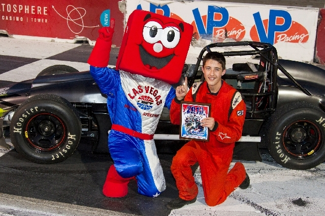 Ian Anderson, 16, right, has the support of Las Vegas Motor Speedway's mascot, but he would like financial support from sponsors to move up from Legend and Thunder cars.