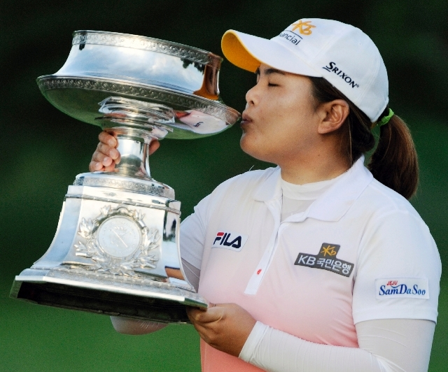 Top-ranked LPGA golfer Inbee Park kisses the trophy after winning the LPGA Championship in Pittsford, N.Y., on June 9. Park, a Bishop Gorman High product, has hit her career stride this season wit ...