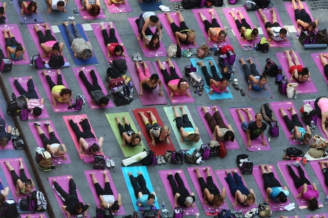 People practice yoga in New York's Times Square on Friday.