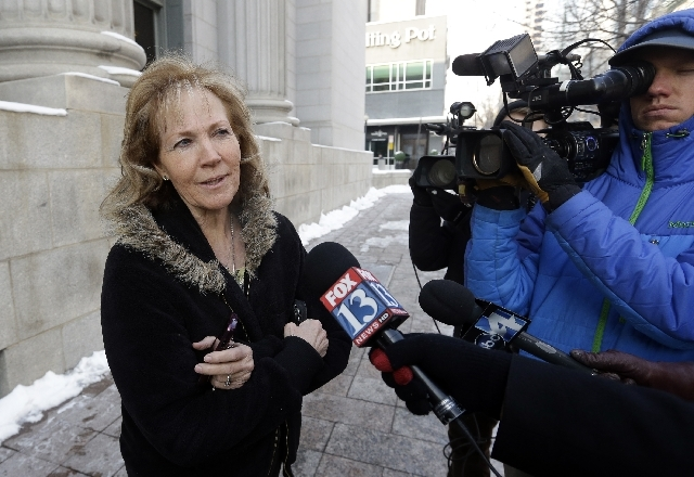 Former polygamist Kristyn Decker, shown here on Jan. 17 in Salt Lake City, speaks with reporters before a hearing on whether Utah can prohibit plural marriage. Decker, who spent 50 years in polyga ...
