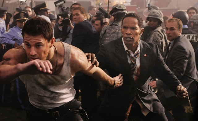 "Channing Tatum (officer John Cale), left, and Jamie Foxx (President James Sawyer) star in the action thriller ""White House Down."""