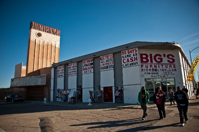 Pedestrians walk past the historic Huntridge Performing Arts Theatre. The theater has housed various businesses since its closure. The Las Vegas Planning Commission will consider a proposal for so ...