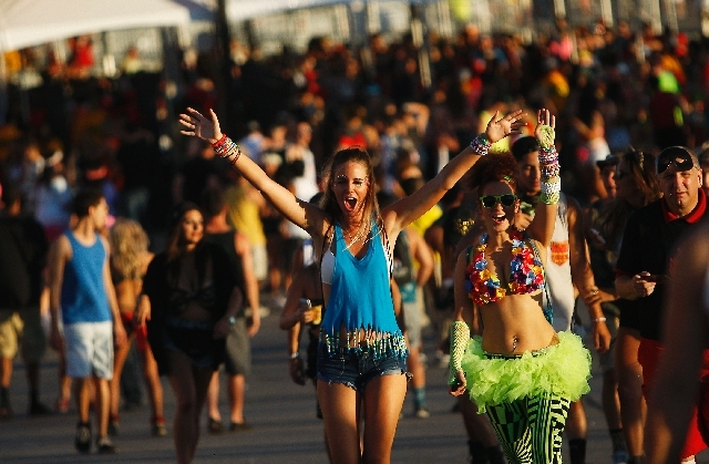 Festival-goer Brittany Coates, middle in blue, makes her way into Insomniac's Electric Daisy Carnival at the Las Vegas Motor Speedway on Friday.