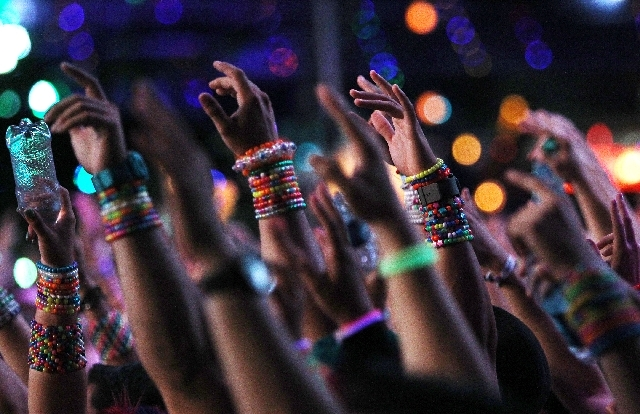 Festival goers dance during Insomniac's Electric Daisy Carnival at the Las Vegas Motor Speedway on Friday.