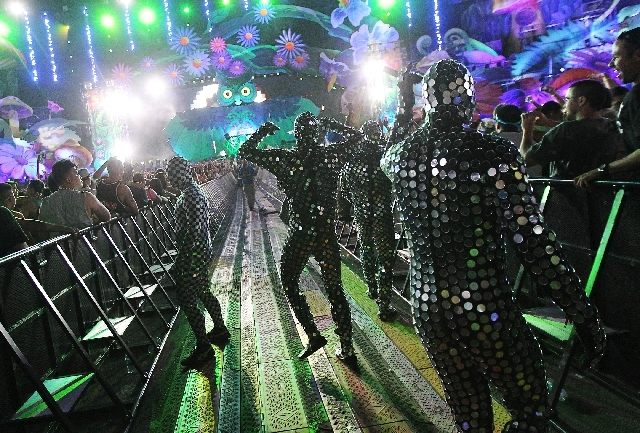 Men in mirror suits entertain the crowd during Insomniac's Electric Daisy Carnival at the Las Vegas Motor Speedway on Friday.