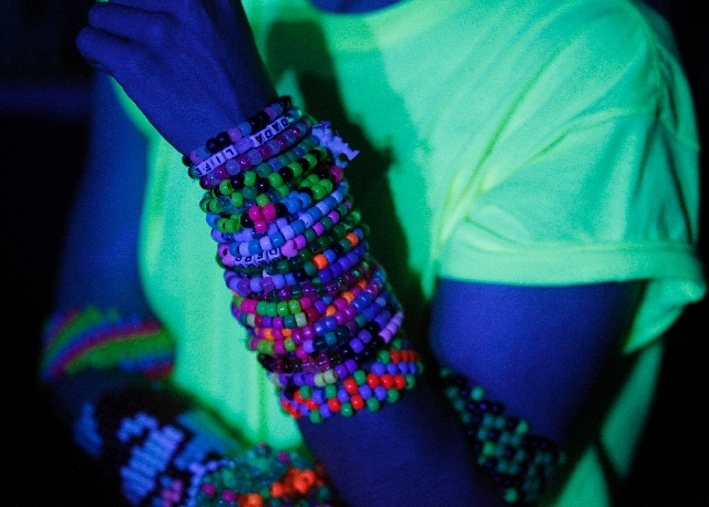 Bracelets cover the arms of a fan during the Electric Daisy Carnival in Las Vegas on Friday.