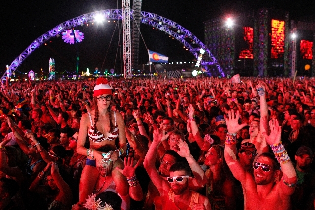 People dance to electronic dance music during the Electric Daisy Carnival in Las Vegas on Friday.