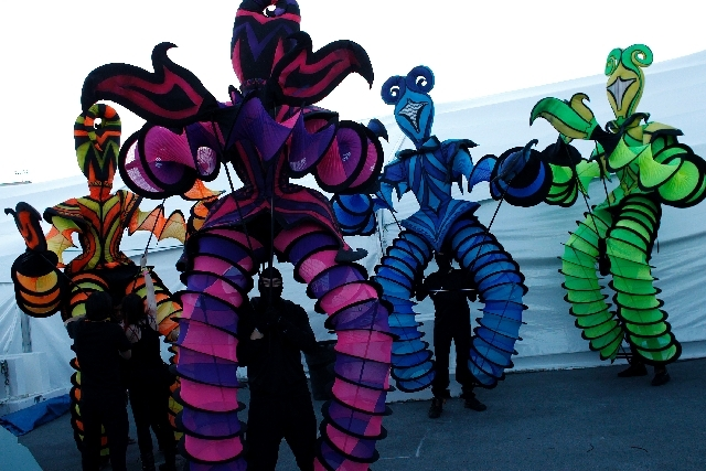 People prepare to perform at Electric Daisy Carnival in Las Vegas on Friday.