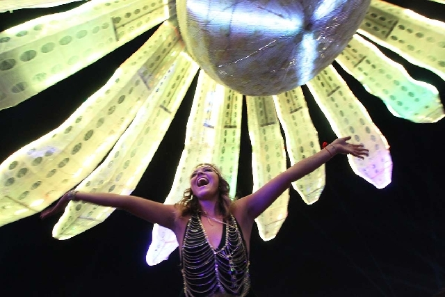 Priscilla Murillo, from San Diego, calls out to her friends during Insomniac's Electric Daisy Carnival at the Las Vegas Motor Speedway on Friday.