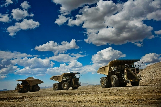 Trucks operate at the Barrick Gold Corp. Cortez Hills mine, located about 70 miles southwest of Elko in this Aug. 7 file photo. Barrick intends to cut about 40 jobs in Nevada because of falling go ...