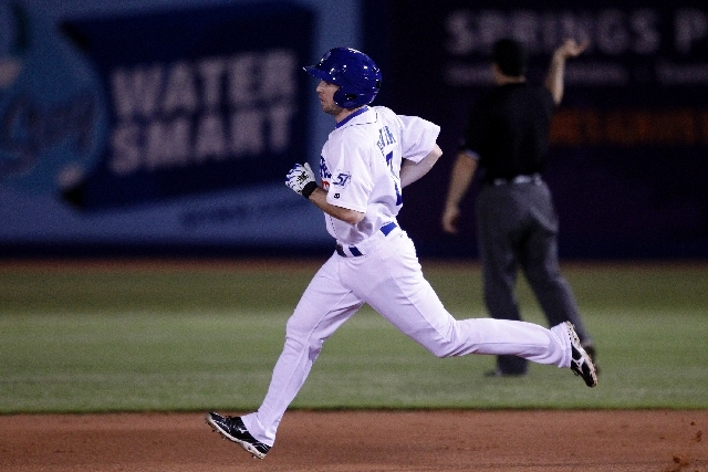 Las Vegas 51s player Mike Baxter rounds the bases after hitting a home run against the Salt Lake Bees in Las Vegas on Saturday. On Sunday, the Bees scored four runs in the eighth inning to beat th ...