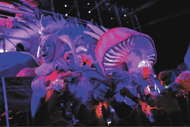 Performers entertain revelers at the Electric Daisy Carnival at the Las Vegas Motor Speedway on Saturday night. This is the third year the electronic music festival has been held in Las Vegas.