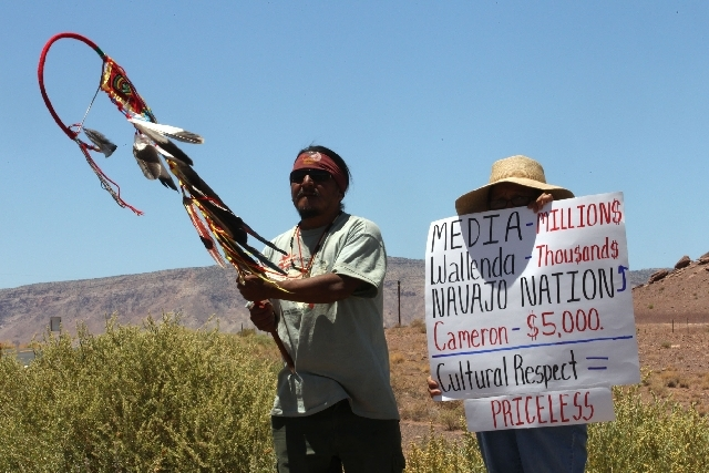 Supai Waters, left, a Haeva Supai tribal member and and a woman who wished to be unidentified protest along highway, near Cameron, Ariz., on Sunday to protest Florida aerialist Nik Wallenda's tigh ...