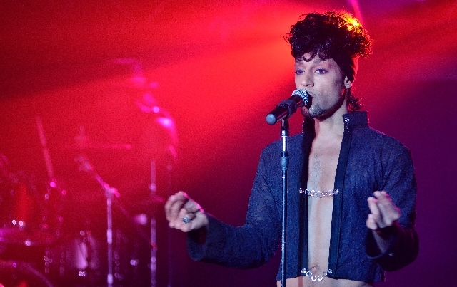 """Jason Tenner performs as Prince during """"Purple Reign: The Prince Tribute Show"""" at Hooters Hotel."""