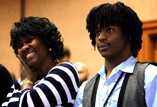 Former Green Valley High School football player LaQuan Phillips, who was temporarily paralyzed as a result of a hit during a game in 2008, right, is recognized after speaking at a press conference ...