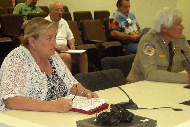 Dr. Rexene Worrel, Nye County's former contract medical examiner, sits with Sheriff Tony DeMeo while answering questions from commissioners on June 18 in Pahrump.