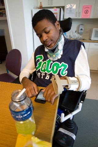 Green Valley High School senior football player LaQuan Phillips, who was paralyzed during a game against Centennial High School on September 5, 2008, sends a text message while at Shriners Hospita ...