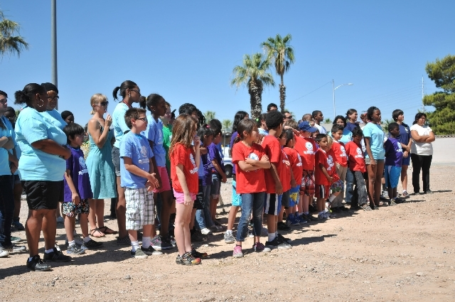 Kids in summer camp at the Stupak Community Center attend the dedication ceremony of the Stupak Park, 300 W. Boston Ave. The park, across Boston Avenue from the Stupak Community Center, will featu ...
