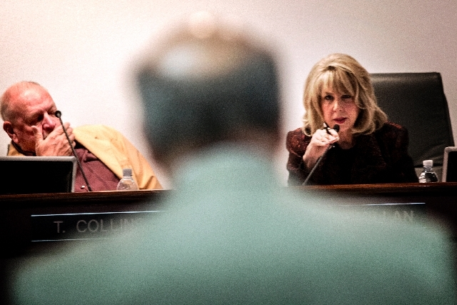 Las Vegas Convention & Visitors Authority board member Kristin McMillan, right, questions Mark Olson (back to camera), LVCVA vice president of human resources, during the compensation committee me ...