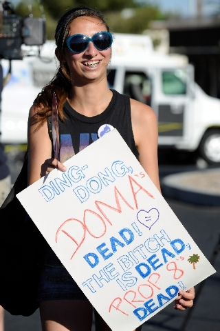 Caitlyn Anderson display a sign during the Supreme Court decision celebration rally at the The Gay and Lesbian Community Center of Southern Nevada on Wednesday.