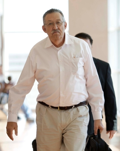 Nurse anesthetist Ronald Lakeman walks toward the courtroom for closing arguments in his his hepatitis C outbreak trial Thursday at the Regional Justice Center.