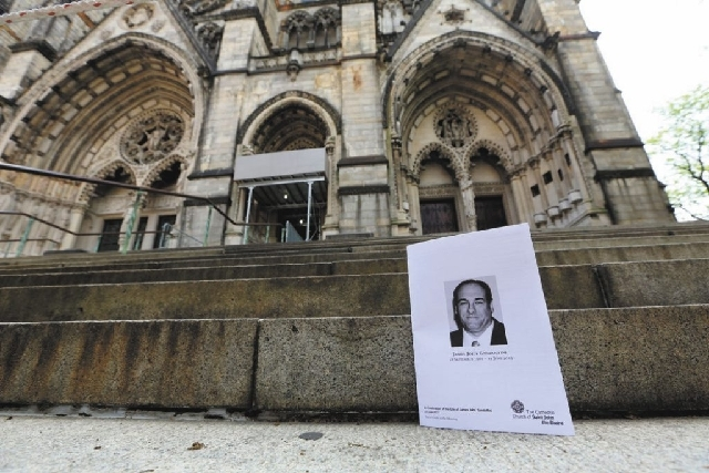 The program for James Gandolfini's funeral is seen outside the Cathedral Church of Saint John the Divine after his funeral service Thursday in New York.
