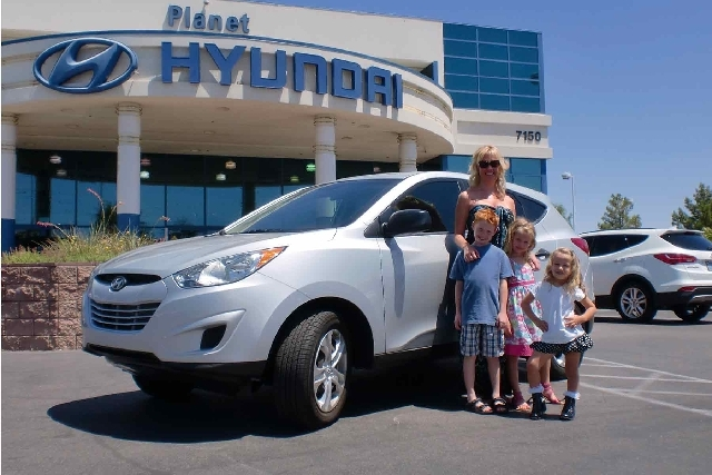 Jennifer Hochberg and her children, from left, Tyler, 8; Hailey, 6; and Hayden, 4, have a new Tucson from Planet Hyundai Sahara, along with a trip to Disneyland.