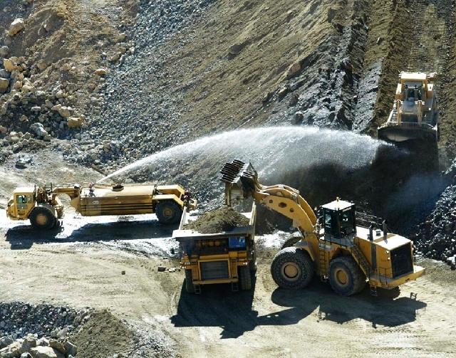Heavy-equipment operators work at Molycorp's mine in 2011. Molycorp shares rose afterhours on Thursday after the company announced the Securities and Exchange Commission had concluded a 10-month i ...