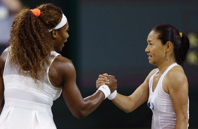 Serena Williams of the United States shakes hands with Kimiko Date-Krumm of Japan after winning their Women's singles match  at the All England Lawn Tennis Championships in Wimbledon, London on Sa ...