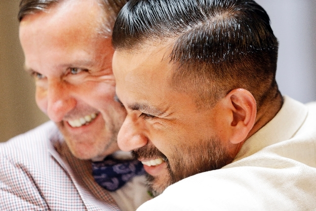 Pete Madril, right, and Monte Young hug afer getting married in San Francisco on Saturday.