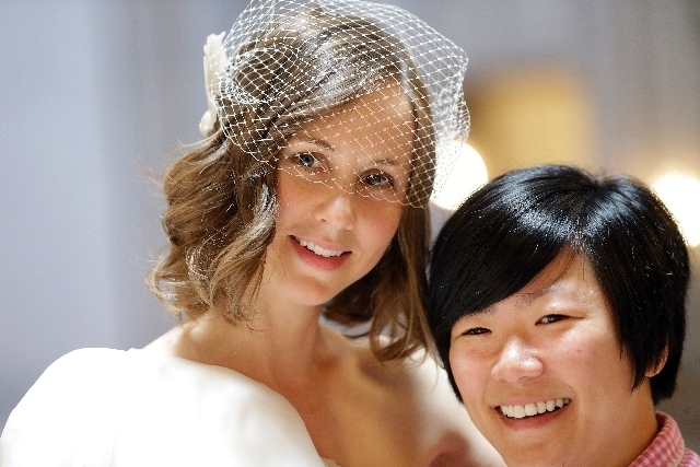 Ashee Meyer-Choi, left, and Ky Meyer-Choi smile as they pose for pictures after marrying at City Hall in San Francisco on Saturday.