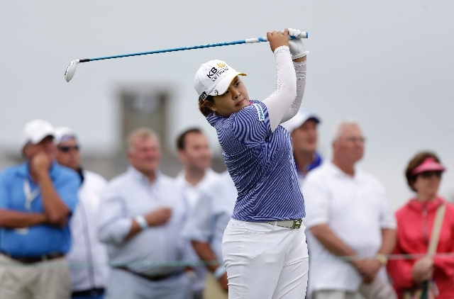 Bishop Gorman graduate Inbee Park tees off the third hole Sunday during the final round at the U.S. Women's Open golf tournament at Sebonack Golf Club in Southampton, N.Y.