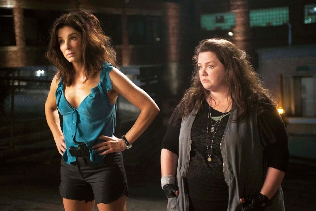 """Sandra Bullock, left, as FBI Special Agent Sarah Ashburn, and Melissa McCarthy, as Boston Detective Shannon Mullins, perform in a scene from """"The Heat."""""""