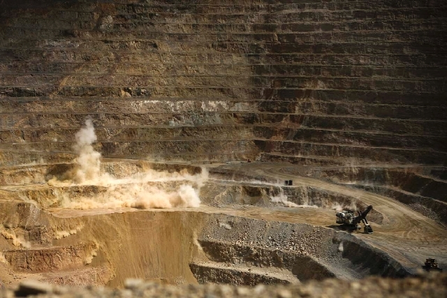 A explosive charge is set off  at the Barrick Gold Corp. Cortez mine, located about 70 miles southwest of Elko, Nevada Tuesday, Aug. 7, 2012.