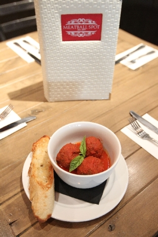 Classic meatballs in classic sauce with garlic toast are seen at Meatball Spot.