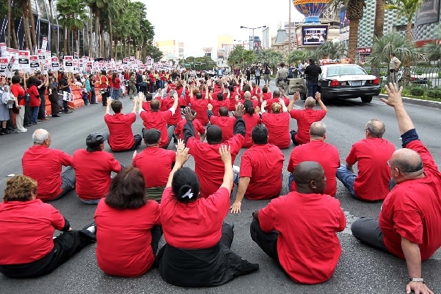 In an act of civil disobedience, members of the Culinary Union block traffic on the Las Vegas Strip in front of the Cosmopolitan Hotel during a planned protest on March 20.