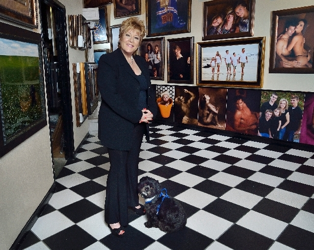 Susan Gomez, who stands with her dog Canon at the entrance to her studio, attributes her career's longevity to her professional commitment.