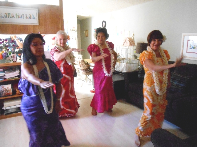 The hula group Aloha Nui Loa practices June 18 in the home of Barbi Baker.