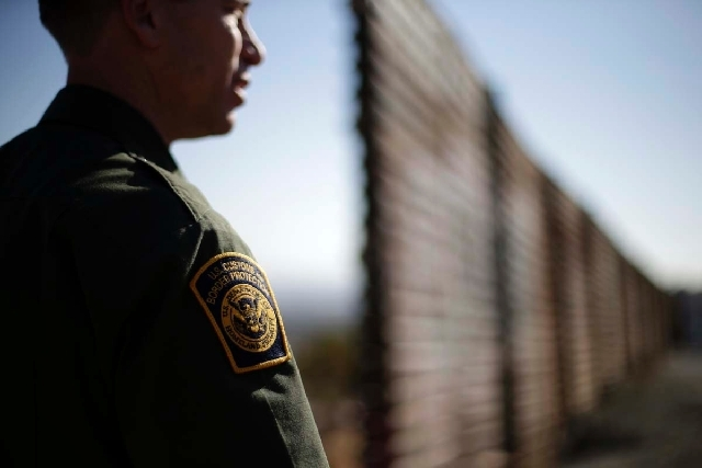 U.S. Border Patrol agent Jerry Conlin looks to the north near where the border wall ends as is separates Tijuana, Mexico, left, and San Diego, right. Immigration reform will likely be a hot topic  ...
