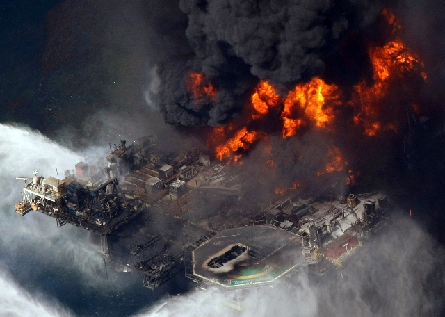 This file aerial photo, the Deepwater Horizon oil rig burns in the Gulf of Mexico more than 50 miles southeast of Venice, La.
