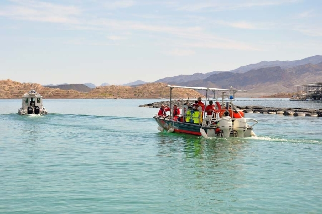 This June 21 file photo provided by the National Park Service shows a crew departing Hemenway Harbor to search for Istvan Tibor Feichtner at Lake Mead. A man's body was recovered in the area on We ...