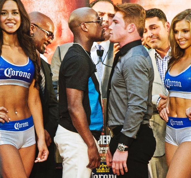 """Floyd Mayweather, center left, poses in a face-off with Saul """"Canelo"""" Alvarez during a boxing news conference on Monday, June 24 at New York's Times Square. MayWeather and Alvarez kicked-off an 11 ..."""