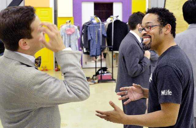 "Director Keith Dotson, right, talks with actor Nick King, who portrays J. Pierrepont Finch in Super Summer Theatre's ""How to Succeed in Business Without Really Trying,"" during a costume check. The ..."