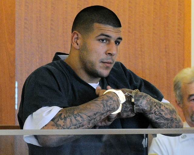 Former New England Patriots football tight end Aaron Hernandez stands during a bail hearing in Fall River Superior Court Thursday, June 27 in Fall River, Mass.