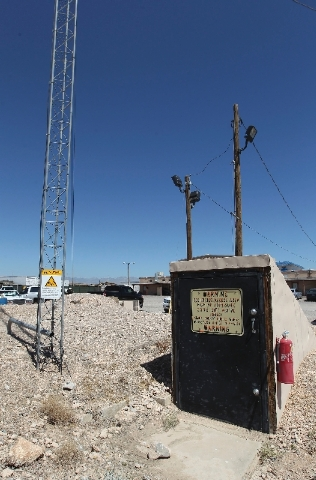 A radio tower stands next to the entrance to a bunker that sits locked and largely forgotten under the dirt parking lot of the Arden maintenance shop.
