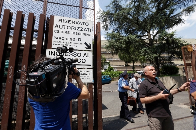 A journalist films with his camera the the main entrance of Rome's tribunal and prosecutors office on Friday.