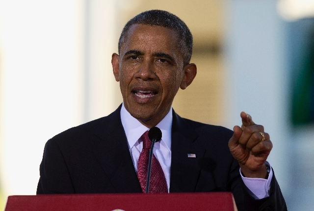 President Barack Obama speaks during a news conference Monday in Tanzania. On Tuesday, the Obama administration announced a one-year delay in a central requirement of the new health care law.